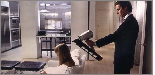 American Psycho: Bateman Aims His Nail Gun